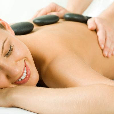 Portrait of attractive woman getting a massage at the day spa